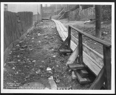 Street Improvement Photographs -- Box 22, Folder 59 (Eichelman Alley) -- print, 1931-03-16