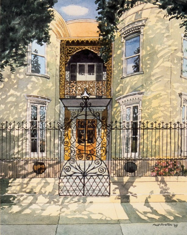 Exterior View of Beige Town House with Iron Gate